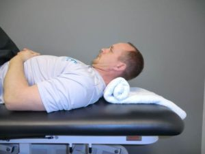 tuck and lift 300x225 Recognizing and Treating Concussions