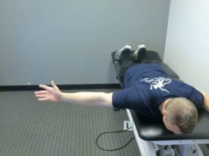 Prone horizontal abduction with external rotation to target the posterior rotator cuff and deltoid.